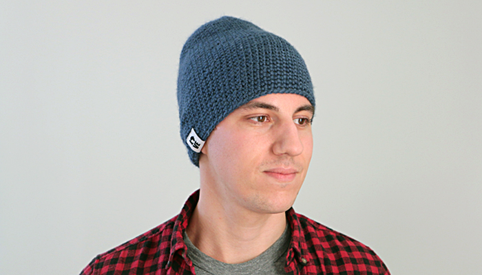 a guy wearing a blue beanie