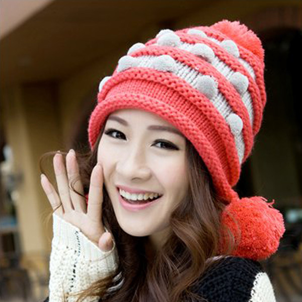 a girl wearing a beanie hat in red and white