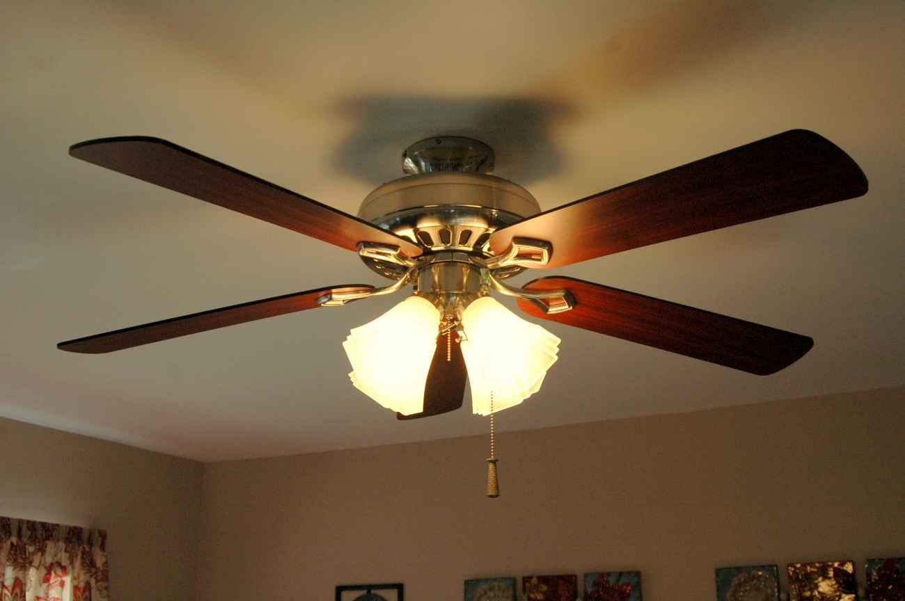 ceiling fan pushes the heat down