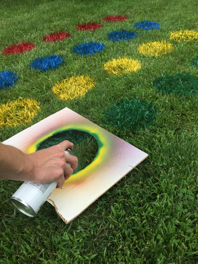 painting twister board on the grass