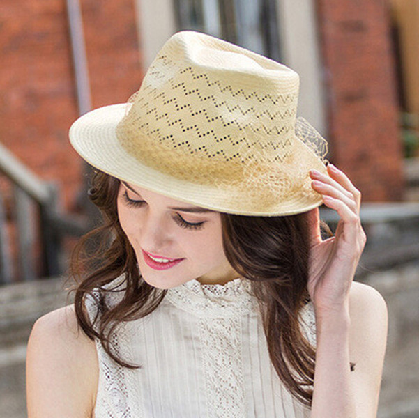 a girl in white dress wearing a straw hat
