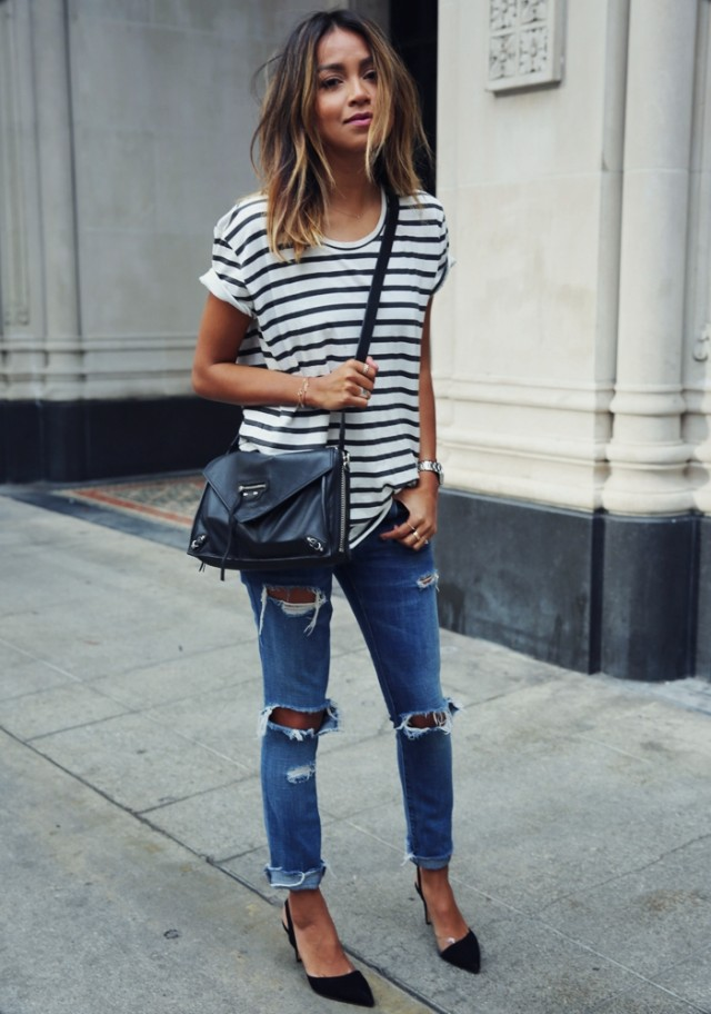 a girl wearing striped outfit