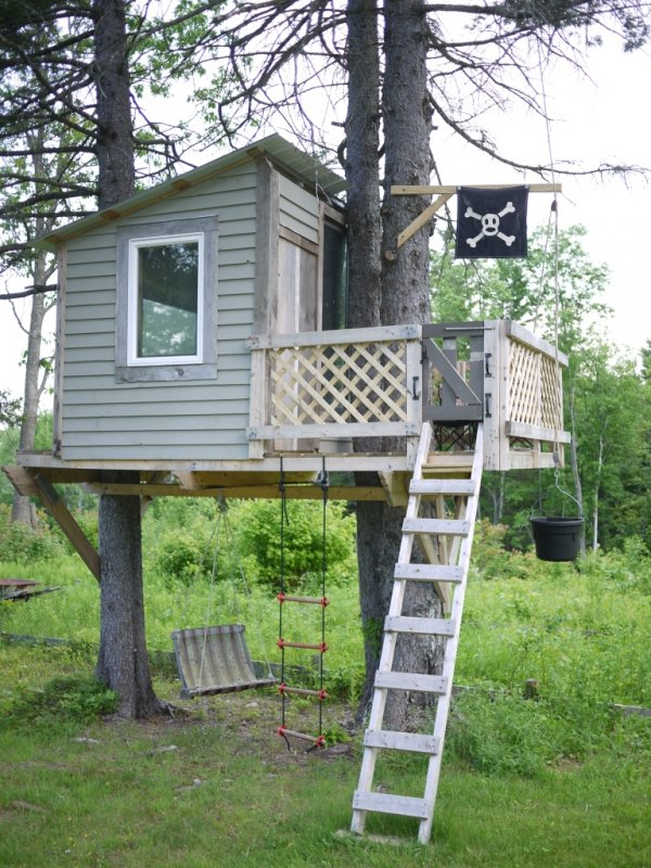 treehouse with a pirate flag