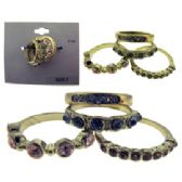 36 Units of Gold Tone Rings With Colored Crystal Accents
