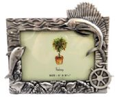 10 Units of Pewter picture frame with a marlin in the top right corner and dolphins along the bottom within the waves of the ocean