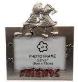 "10 Units of Picture frame with cartoon boy and girl sitting on top of the frame and the word ""friends"" written across the bottom"