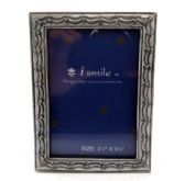 10 Units of Small pewter picture frame with a wavy engraved design resembling a stage curtain