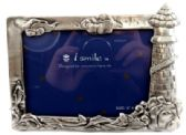 6 Units of Pewter picture frame with clouds on the top, ocean, waves, and dolphin on the bottom, and a lighthouse on the right side of the frame