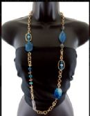 12 Units of Long necklace with assorted patterns of gold tone and shades of blue semiprecious stone charms spaced throughout the necklace - Necklace
